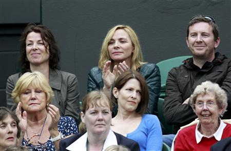 Actress Kim Cattrall watches the match between Venus Williams of the U.S. and Kimiko Date-Krumm of Japan at the Wimbledon tennis championshi