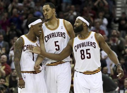 Cleveland Cavalier's Daniel Gibson, Ryan Hollins and Baron Davis celebrate during the fourth quarter of their NBA basketball game against th