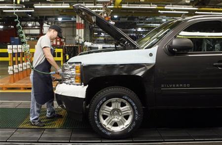 A General Motors auto assembly worker works on assembling a Chevrolet Silverado pickup truck at the Flint Assembly in Flint, Michigan