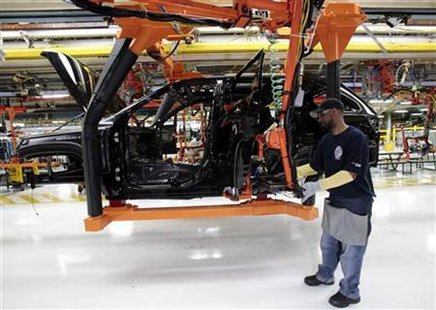 Chrysler auto assembly worker Michael Ricks works on the assembly line attaching doors to the all-new 2011 Jeep Cherokee's at the Jefferson