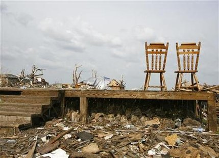 Two kitchen chairs are seen following the May 22 tornado in Joplin