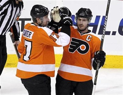Philadelphia Flyers' Richards celebrates his game-winning goal against Ottawa Senators with teammate Carter during their NHL hockey game in