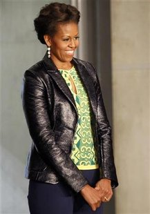 First lady Michelle Obama looks on during a visit to Cape Town stadium,