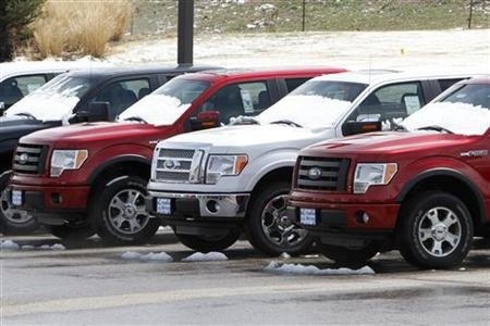 A row of new Ford F-150 pickup trucks are parked for sale at a Ford dealer in the Denver suburb of Broomfield