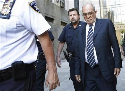 Former Egyptian banker Mahmoud Abdel-Salam Omar leaves Manhattan Criminal Court after his court appearance in New York
