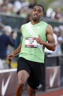 Tyson Gay finishes the men's 100 meters heat at the U.S. Outdoor Track and Field Championships in Eugene