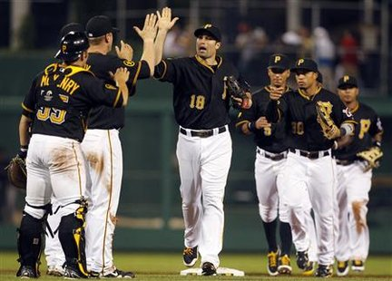 Pittsburgh Pirates Neil Walker celebrates with his teammates in Pittsburgh