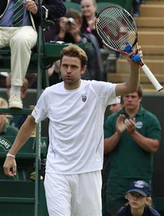 Mardy Fish of the U.S. waves after defeating Denis Istomin of Uzbekistan at the Wimbledon tennis championships in London