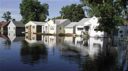 Homes are reflected in flood waters at Minot