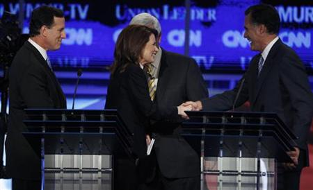 Republican presidential hopefuls shake hands at end of first New Hampshire debate of the 2012 campaign in Manchester