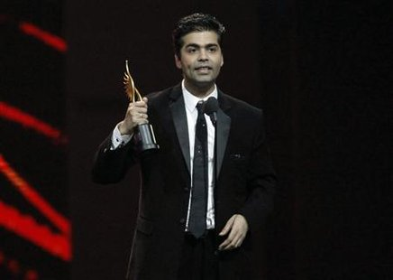 Johar accepts his award for best directo rduring the IIFA awards show in Toronto