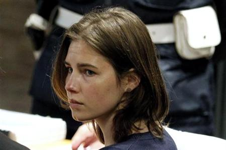 Knox, the U.S. student convicted of killing her British flatmate in Italy three years ago, sits in the courtroom before a trial session in P