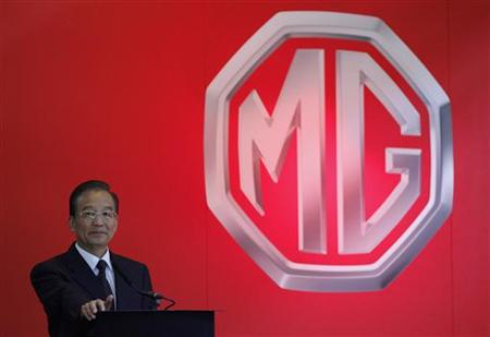 Chinese Premier Wen Jiabao delivers a speech during his visit to the MG motor plant in Birmingham