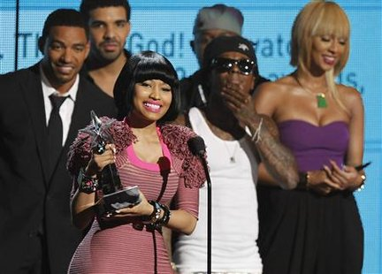 Nicki Minaj accepts best female hip hop artist award at the 2011 BET Awards in Los Angeles