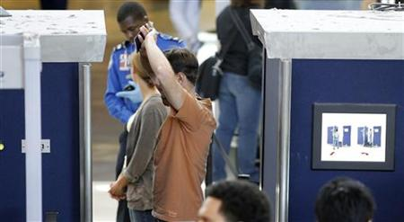 A man is screened with a backscatter x-ray machine at a TSA security checkpoint in terminal 4 at LAX, Los Angeles International Airport, in