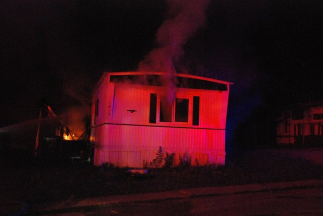 A trailer in Kalamazoo is fully engulfed in flames - a passing motorist helped everyone escape unharmed. Photos by Sean Patrick Duross.