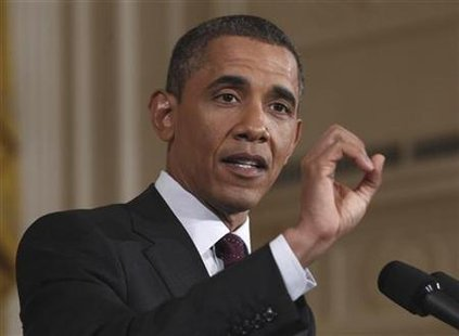 U.S. President Obama gestures as he answers a question during a news conference in Washington