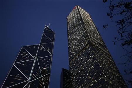 A evening view of Cheung Kong Centre and the Bank of China Tower at Hong Kong's business Central district