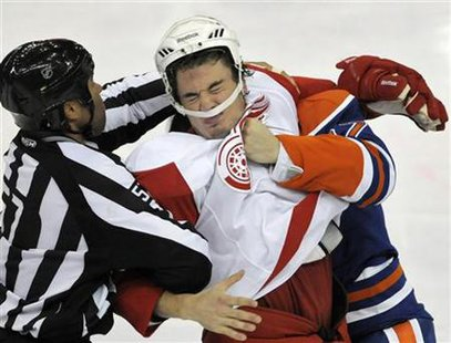 Detroit Red Wings' Jonathan Ericsson is punched by Edmonton Oilers' Gilbert Brule during the second period of their NHL hockey game in Edmon