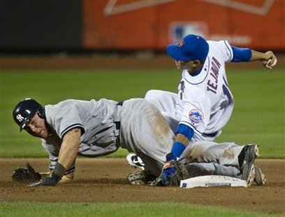 New York Yankees Martin gets tangled with New York Mets Tejada as he breaks up double-play in New York