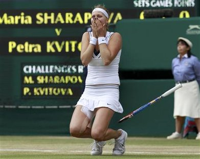 Petra Kvitova of the Czech Republic celebrates after defeating Maria Sharapova of Russia in their final match at the Wimbledon tennis champi
