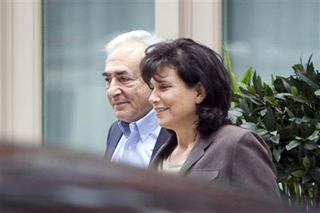 Former IMF chief Dominique Strauss-Kahn and his wife Anne Sinclair leave their temporary Manhattan residence in New York