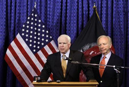 John McCain speaks as Joe Lieberman looks on during a news conference at the International Security Assistance Force headquarters in Kabul