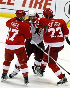 Phoenix Coyotes center Lombardi gets caught between Detroit Red Wings rightwing Eaves and defensman Stuart during their Western Conference q