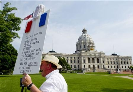 Erik Meade protests in front of the closed Minnesota State Capital in Saint Paul