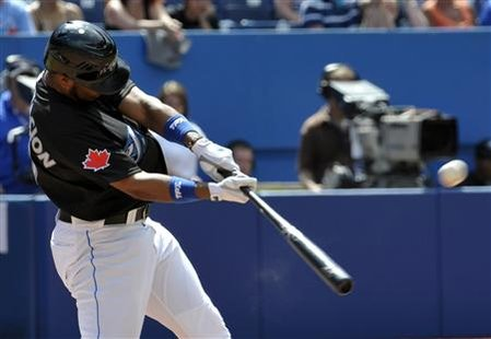 Blue Jays batter Encarnacion hits a two-run home run against the Phillies during the eighth inning of their MLB interleague baseball game in