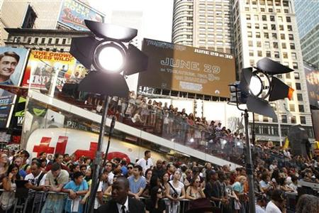 "A crowd gathers in Times Square to watch celebrities arrive during the premiere of ""Transformers: Dark of The Moon"" in New York"