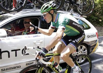 HTC-Highroad rider Cavendish gives a thumb up to his team manager during the Tour de France 2011 cycling race
