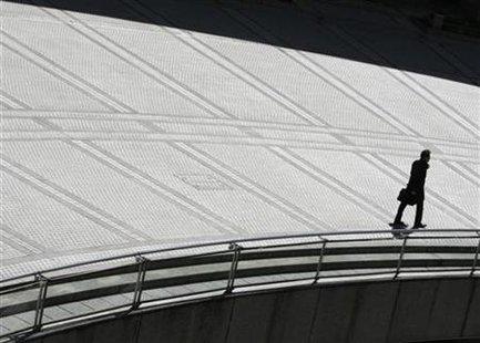 A businessman walks in Tokyo