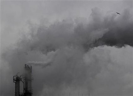 Smoke billows from chimneys at an industrial district near Tokyo