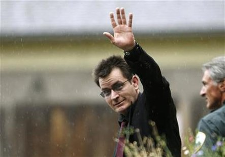 Actor Charlie Sheen gestures towards the media as he leaves the Pitkin County Courthouse after a sentencing hearing in Aspen