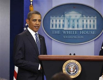 U.S. President Obama walks out to talk about deficit reduction at the White House in Washington