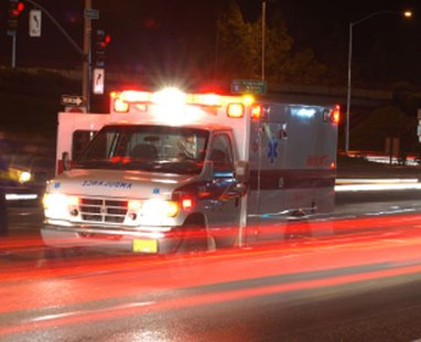 An ambulance rushes towards the scene of an accident.