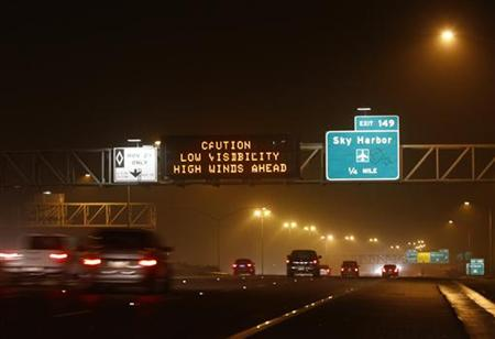 Motorists drive along Interstate-10 during a dust storm in Phoenix