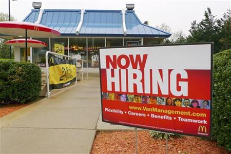 "A ""Now Hiring"" sign is seen in front of a McDonald's restaurant in FairOaks"