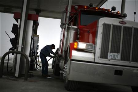 Truck driver Randy Walker fills his rig with biodiesel fuel in Nevada, Iowa