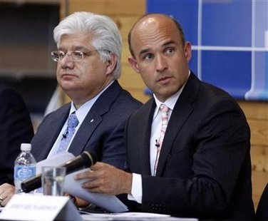 Research in Motion co-CEO Jim Balsillie and President and co-CEO Mike Lazaridis listen during the annual general meeting of shareholders in