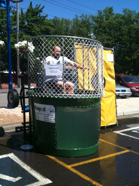 Justin in the dunk tank raising money for the Hibbing Food Shelf