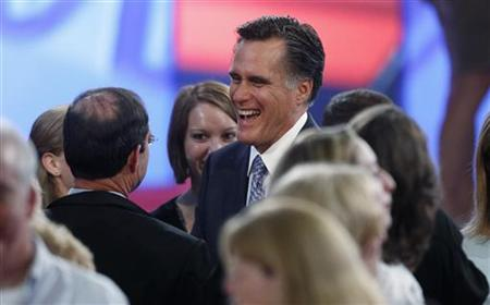 Former Massachusetts Governor Romney talks with the audience after the first New Hampshire debate of the 2012 campaign at St. Anselms Colleg