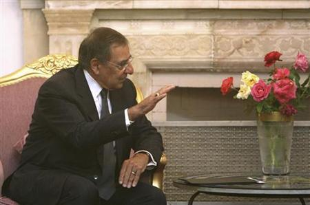 Afghan President Hamid Karzai speaks with the new U.S. Defense Secretary Leon Panetta at the presidential palace in Kabul