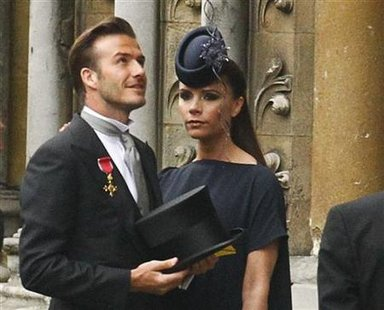 Soccer star David Beckham and his wife Victoria arrive at Westminster Abbey before the wedding of Britain's Prince William and Kate Middleto