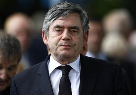 Britain's former Prime Minister Gordon Brown arrives for the funeral of former union official Jimmy Reid at the Govan Old Parish Church in G