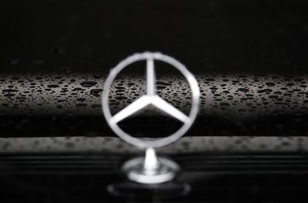 The Mercedes logo is displayed on a limousine car parked outside the European Commission headquarters in Brussels