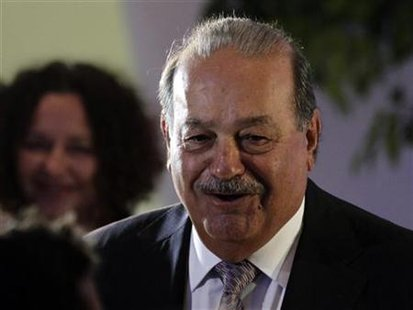 Mexican tycoon Carlos Slim arrives to attend the opening of the Soumaya museum in Mexico City