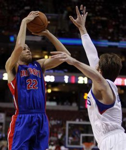 Detroit Pistons forward Tayshaun Prince (22) shoots under pressure from Philadelphia 76ers forward Andres Nocioni (R) during the first quarter of their NBA basketball game in Philadelphia, Pennsylvania April 13, 2011. REUTERS