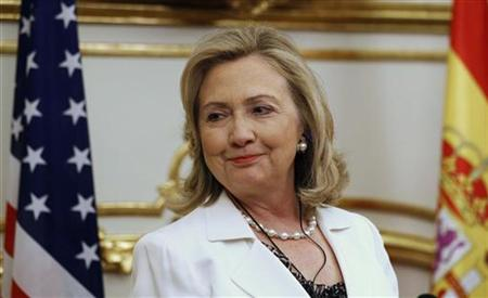 U.S. Secretary of State Clinton smiles during a joint news conference with Spanish Foreign Minister Jimenez in Madrid